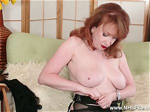 big-chested red finger pummels beaver in garter nylons and pumps