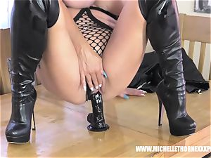 Oily platinum-blonde biker babe drains with a ginormous ebony toy