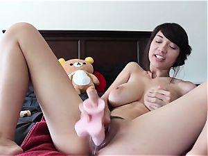 mischievous asian stunner has a fresh plastic friend