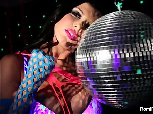 Romi plays w disco ball then tucks toys in her slit