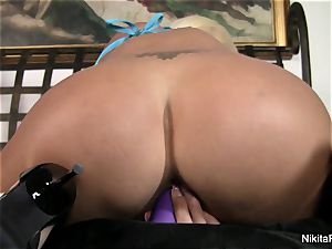 steaming blondie Nikita plays with a purple fucktoy
